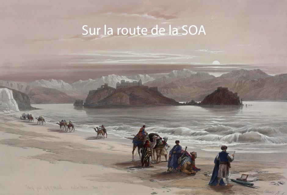 Caravane de marchands au bord d'une plage